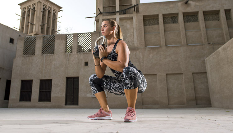 women training squat dubai